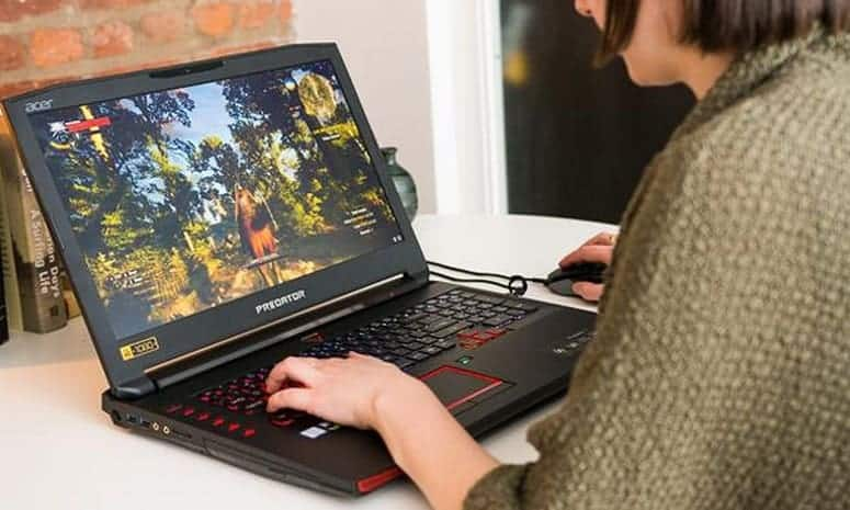 Girl Playing Games On Laptop